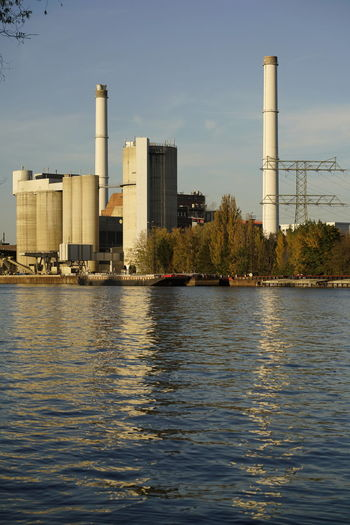 Klingenberg Power Plant Water Built Structure Factory Building Exterior Architecture Industry Smoke Stack Waterfront Sky Fuel And Power Generation Nature No People River Day Pollution Industrial Building  Outdoors Environmental Issues Tall - High Air Pollution Cooling Tower Spree River