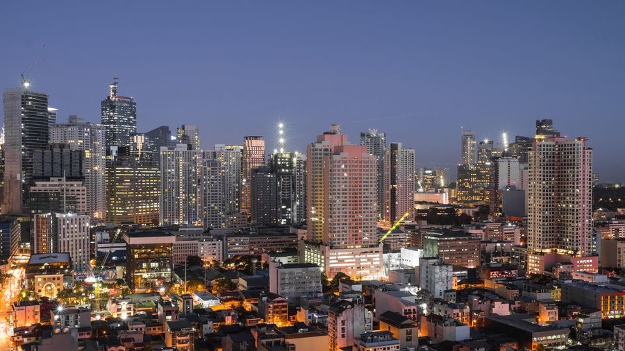 Manila city at blue hour Building Exterior City Architecture Building Cityscape Built Structure Office Building Exterior Skyscraper Sky Illuminated Urban Skyline Residential District Modern Tall - High Financial District  Manila Manila, Philippines Makati Makati City ASIA Blue Blue Hour Concrete Jungle
