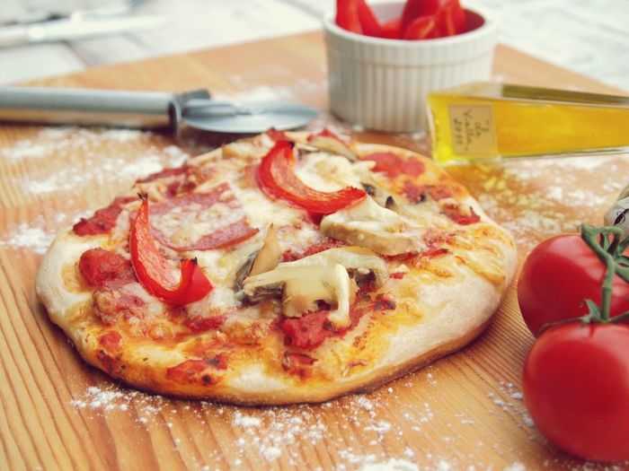 Close-Up Of Pizza On Chopping Board