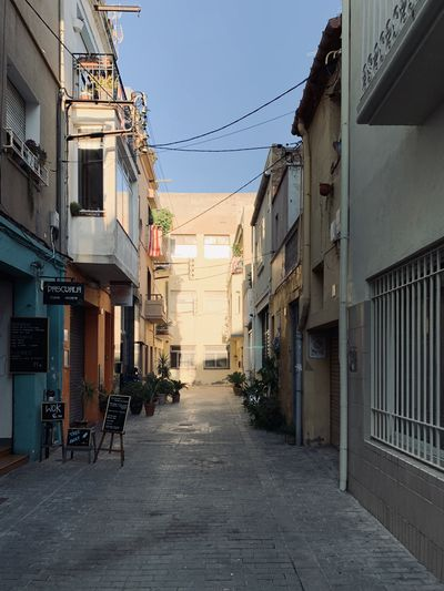 Empty alley amidst buildings in city