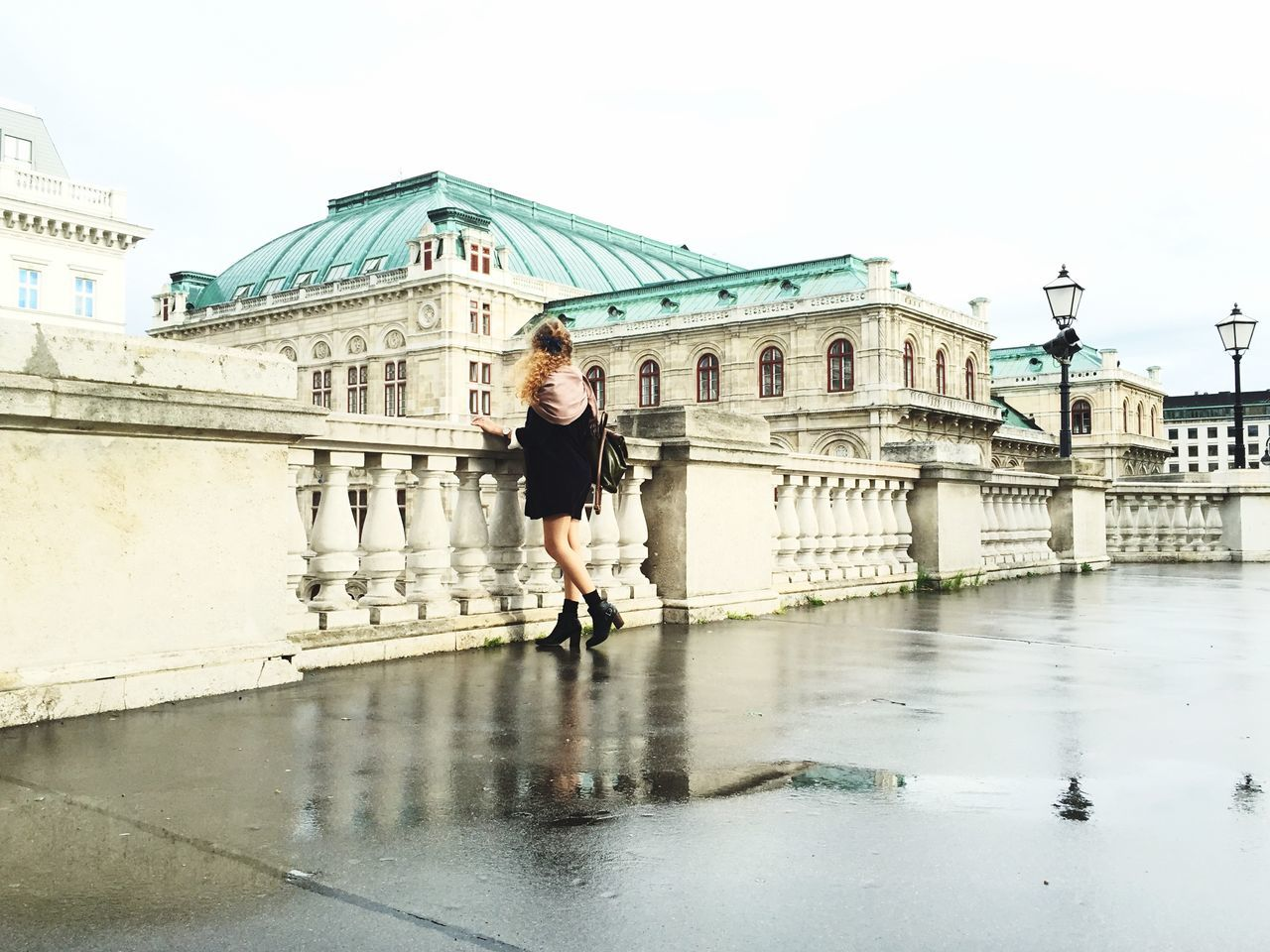 Girl looking at historic buildings while standing on terrace