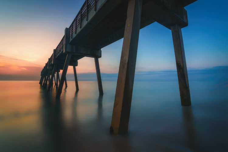 Today's sunrise at the pier. Sky Water Sea No People Tranquility Nature Built Structure Scenics - Nature Beach Architecture Beauty In Nature Reflection Pier Land Outdoors Florida Nature_collection Concrete Pastel Color Glow