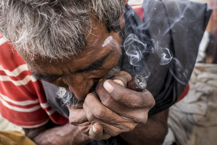 Man smoking his pipe captured at Sonepur Mela, Bihar Adult Bihar Hajipur Hands India Lifestyles Man Smoking One Person Opium Outdoors Pipe Smoke Smoking Smoking Hookah Smoking Pipe Sonepur Sonepurmela Tobacco Travel Travel Photography