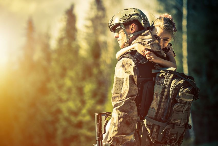 Daughter Giving Her Returning Father Big Hug. Returning Home Soldier. Returning Home Soldier Adult Army Army Soldier Boys Camouflage Clothing Child Childhood Day Headwear Helmet Military Military Life Military Uniform Nature Outdoors People Smiling Special Forces Tree Two People Weapon Young Adult