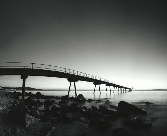 Bridge - Man Made Structure Shore Rock - Object Built Structure Clear Sky Sea Connection Water Beach Architecture Coastline Nature Day Tranquil Scene Bridge Scenics Tranquility No People Sky SPAIN Catalunya Badalona Blackandwhite Eye4photography  EyeEm Best Shots