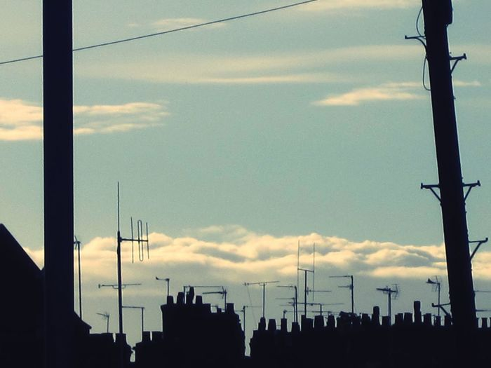 Just as the sun goes down in Rushden Sky Cloud - Sky Silhouette Antenna - Aerial Horizontal Rooftop Scenery Outdoors Silhouette Chimney Tops Higgledy-piggledy Exceptional Photographs Copy Space Blue Sky Fine Art Photograhy Fine Art Embrace Urban Life