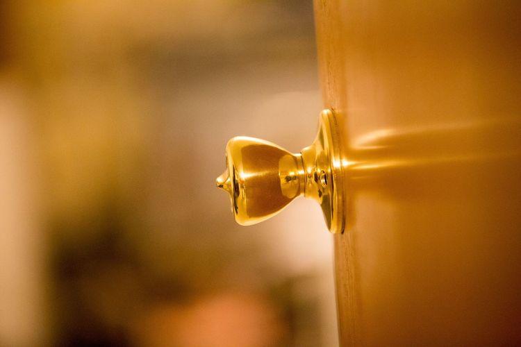 Close-up of gold doorknob