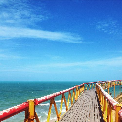 Pier On Sea Against Blue Sky
