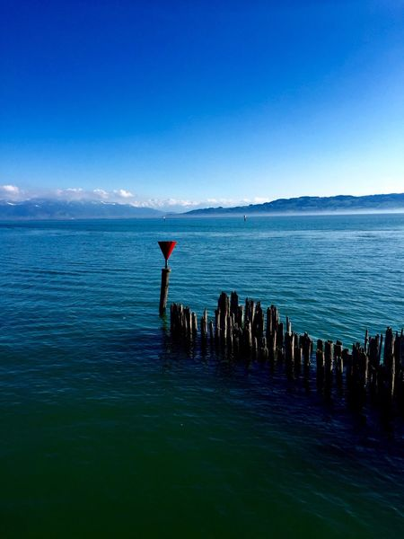 Untiefe Beauty In Nature Blue Calm Day Horizon Over Water Idyllic Majestic Nature No People Non Urban Scene Ocean Outdoors Rippled Scenics Sea Seascape Sky Tourism Tranquil Scene Tranquility Wasserburg Am Bodensee Water Wooden Post