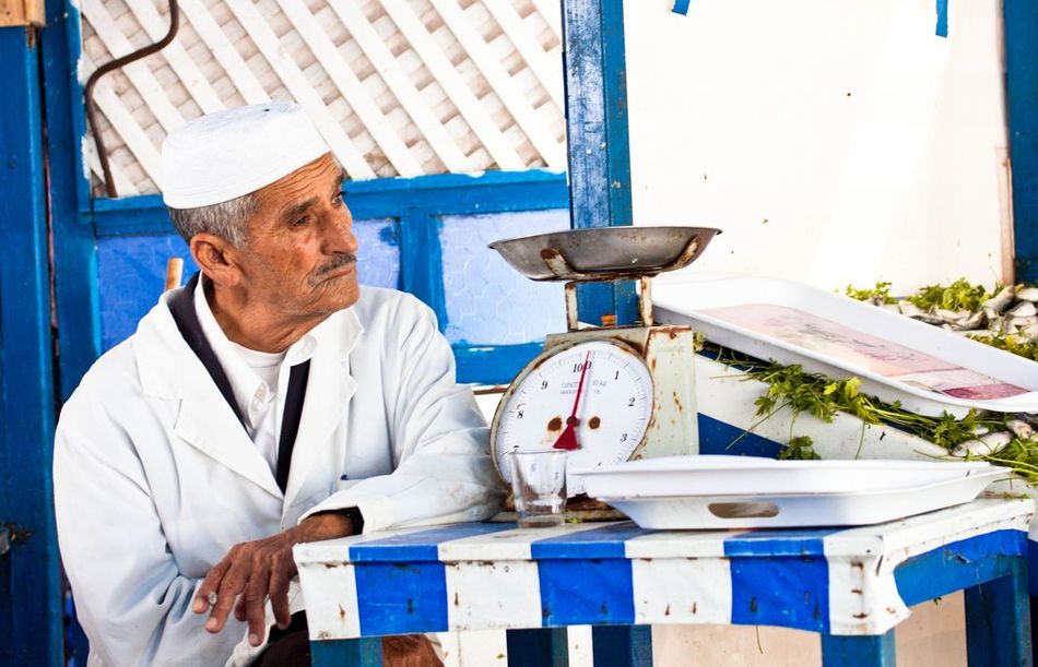Arabic Morocco Moroccan Old Man Vendor Street Vendor Market Seafoods Fresh Fish Fish Blue And White Culture Wrinkles