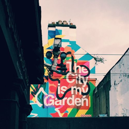 Streetart Graffiti Citygarden Multi Colored Outdoors Built Structure Low Angle View Day Text No People Architecture Building Exterior Colour Your Horizn