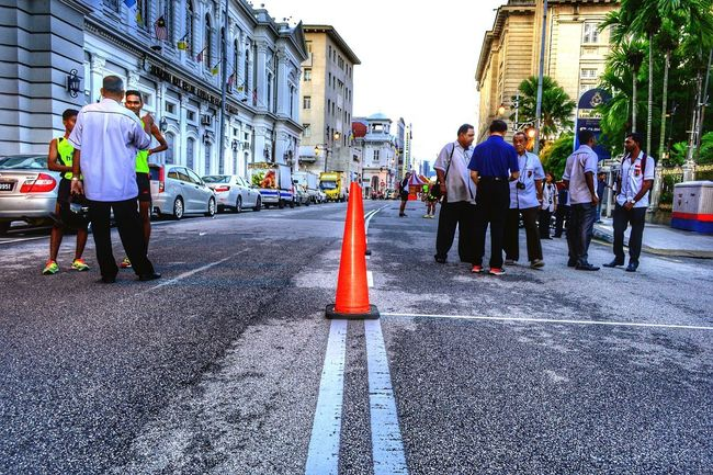 The middle of the road, orange street cone, before the running race begins, Penang, Malaysia. Multi Colored Nawfal Johnson Outdoors Penang, Malaysia Foot Race Orange Street Cone Middle Of The Road Real People Men ASIA Adult