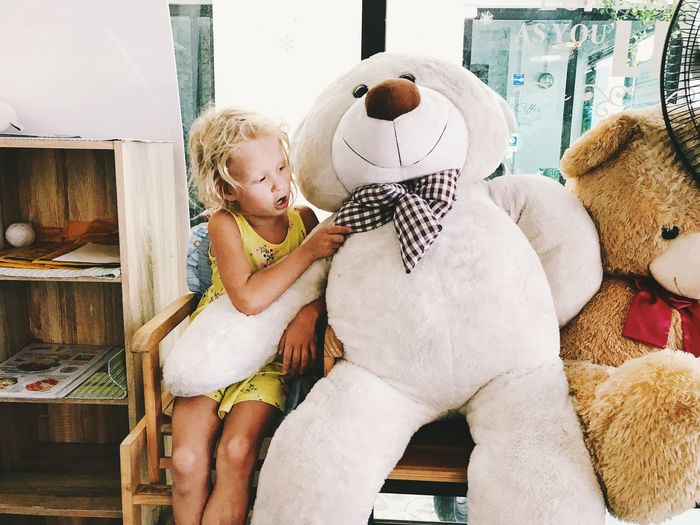 Childhood Real People Child Toy Girls Females Women Stuffed Toy Indoors  Togetherness Two People Lifestyles Teddy Bear Leisure Activity Three Quarter Length Sitting People Casual Clothing Family Positive Emotion Innocence Daughter