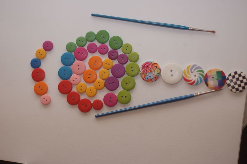 High angle view of colorful buttons on table
