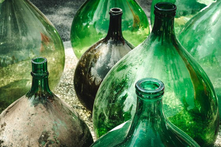 Close-up of green bottles