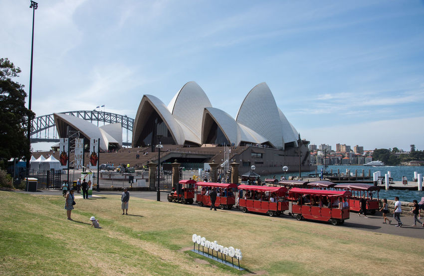 Sydney,NSW,Australia-November 20,2016: Sydney Opera House, Sydney Harbour Bridge, Royal Botanic Gardens and tourists in Sydney, Australia 20th Century Architecture Australia Crowds Exploring Harbour Landmarks Modern Architecture Royal Botanic Gardens Sydney Harbour Bridge Sydney Opera House Tourist Tourist Attraction  Travel Arch Bridge Landmark Leisure Activity People Real People Sydney Tourism Train Waterfront Weekend Activities