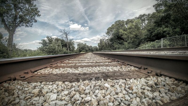 Tree Railroad Track Surface Level Sky Diminishing Perspective Pebble Day Outdoors Gravel Cloud - Sky Vanishing Point Nature Straight Long Nature No People Train Bridge Aestethic Bridge - Man Made Structure Train Man Made Structure Train Tracks Tranquil Scene Cloud Park
