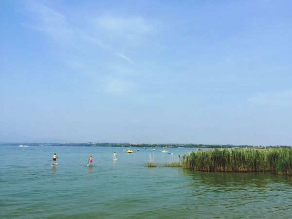 PeschieraDelGarda Del Garda Italian Lake Water Real People Sky Nature Scenics Sea Beauty In Nature Outdoors Tranquility Day Tranquil Scene Tree Leisure Activity Nautical Vessel Men Paddleboarding Vacations People