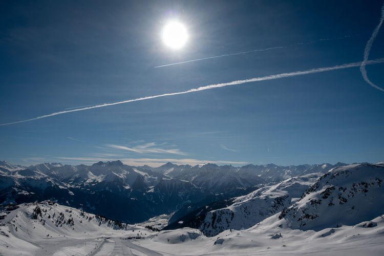 Mountain Snow Cold Temperature Sky Winter Scenics - Nature Beauty In Nature Mountain Range Cloud - Sky Snowcapped Mountain Nature Vapor Trail Tranquility Tranquil Scene Environment No People Sunlight Sun Non-urban Scene Outdoors Bright Lens Flare Mountain Peak