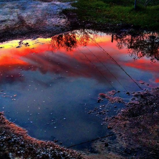 Nightphotography Sunsetreflections Sunset #sun #clouds #skylovers #sky #nature #beautifulinnature #naturalbeauty Photography Landscape [a:1249] Oil Puddle Oil And Water Showing Imperfection