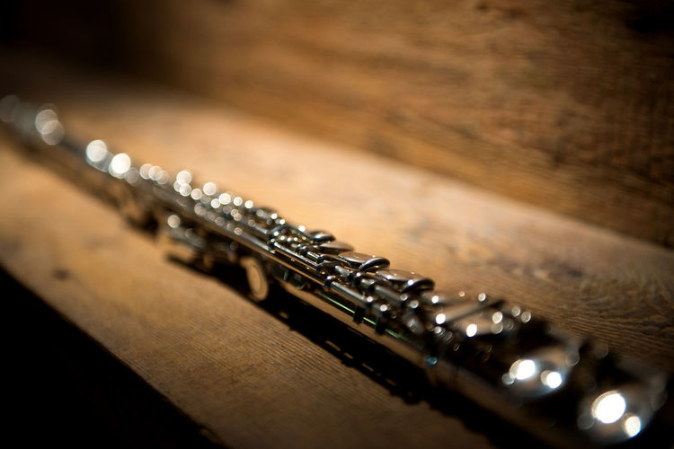 Close-Up Of Wind Instrument On Table