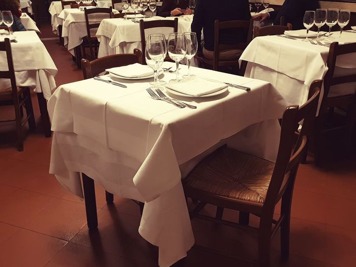 Roma o Morte Table Restaurant Seat Tablecloth Place Setting Dining Table Food And Drink Drinking Glass Wineglass Furniture Dinner Dining No People White Color Indoors  Chair Setting Household Equipment Rome Crockery Italian Food