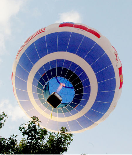 Low angle view of air hot balloon against sky