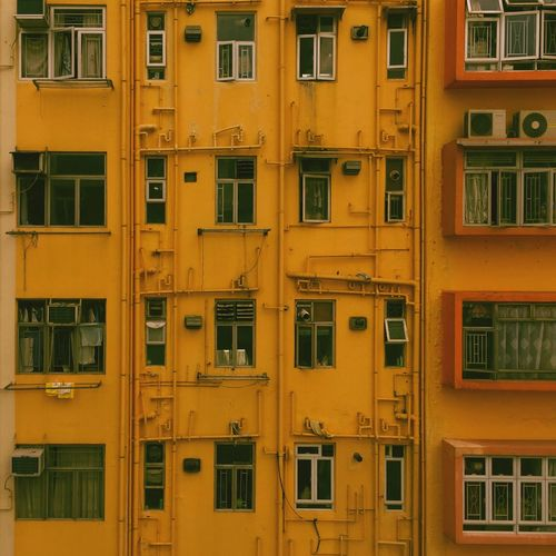 Tsim Tsan Tsui Pattern Architecture Window Building Exterior Outdoors Full Frame Built Structure No People Backgrounds Yellow Day City First Eyeem Photo