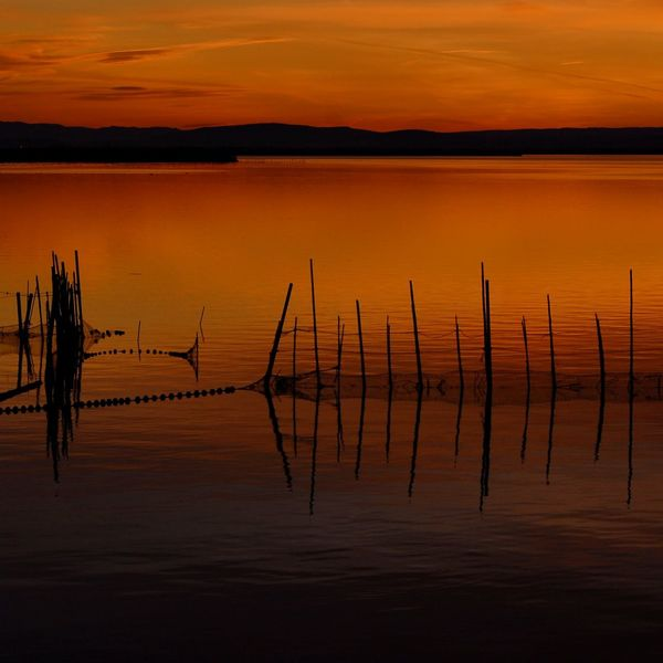 Sunset Water Lake Silhouette Landscape Scenics Sky Nature Horizon Over Water No People Horizon Tranquility Aquatic EyeEm Nature Lover Clear Sky Tranquil Scene Tranquility Nature Idyllic Orange Color