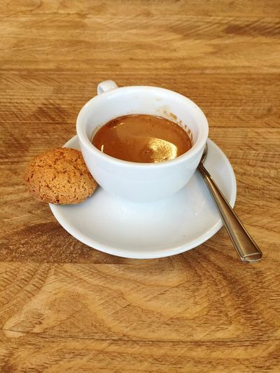 Double Espresso in a White Cup oh and a Scrummy Amaretti  Biscuit On The Side