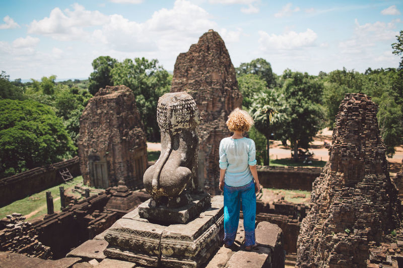 Rear View Of Mid Adult Woman Standing At Ankor Wat Temple