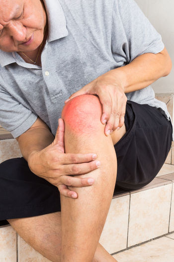 Asian man with painful inflamed knee Asian  Gout Stairs Steps Body Part Healthcare And Medicine Home Interior Human Body Part Inflammation Knee Malaysia Men Pain Physical Injury Real People