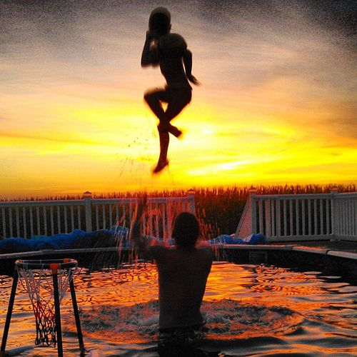 The Most Amazing Sunset Beautiful Moment💙 Daddy's Little Girl Daddy's Sunshine Beautiful Sunset♥♥Good Evening EyeEm Water Full Length Sunset Men Silhouette Mid-air Stunt Jumping Orange Color Sky EyeEmNewHere