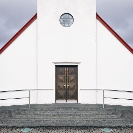 The Architect - 2018 EyeEm Awards Symmetrical Symmetry Wooden Door Steps And Staircases Steps Minimal Minimalism Simplicity White Color Built Structure Entryway Door Architecture Building Exterior Shapes And Forms Structure Church Iceland Place Of Worship Architecture Entrance No People Day Building Closed Façade Shape