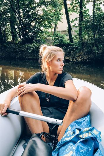 Sitting One Person Young Adult Young Women Real People Sitting One Person Young Adult Young Women Real People Women Lifestyles Blond Hair Water Leisure Activity Nature Beautiful Woman Adult Hair Three Quarter Length Day Casual Clothing Hairstyle