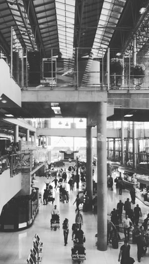 📷 Travel Real People Built Structure Transportation Indoors  Day Men Walking Large Group Of People Women Public Transportation People Adult Airport Black & White Mono Monochrome Monochrome Photography IPhone IPhone7Plus IPhone Photography Lifestyles Shadow B&W Magic