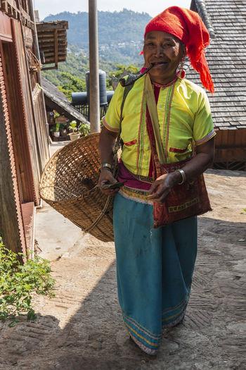 Full length of man standing in basket
