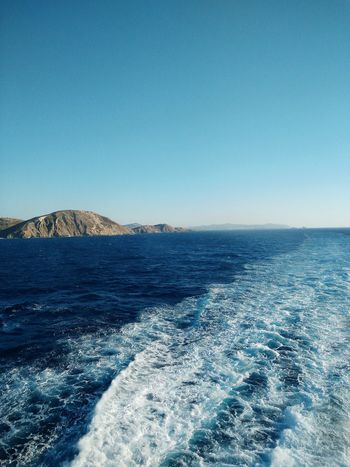 The Journey Is The Destination On The Way Boat Ride Ferry Ride Leaving Home Behind Blue Water Blue Sky Waves White Waves Rocks And Water Island Rocky Coastline Showcase July
