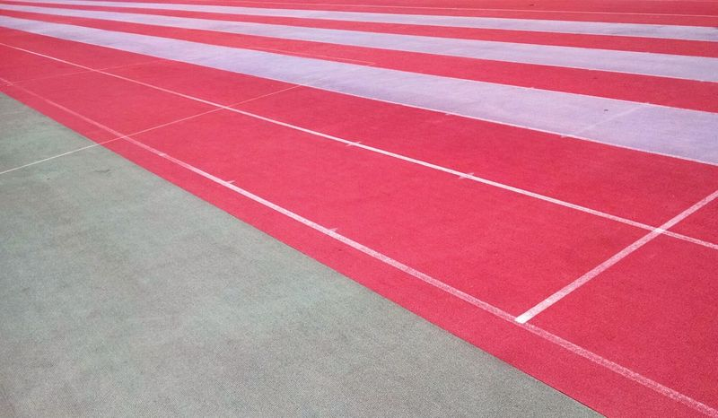Flag. Athletics Field Runners Empty Places High Contrast Synthetic Summer Views Lines Urban Geometry Deceptively Simple Seeing The Sights My Best Photo 2015 Pattern Pieces Need For Speed Colour Of Life The Color Of Sport Minimalist Architecture