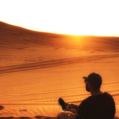 Sunset Real People One Person Nature Desert Leisure Activity Silhouette Lifestyles Scenics Landscape Beauty In Nature Sky Arid Climate Outdoors Sand Dune Mammal Day People Adult EyeEmNewHere EyeEm Best Shots EyeEmBestPics Eyemphotography Eyem Best Shots Eyem Gallery