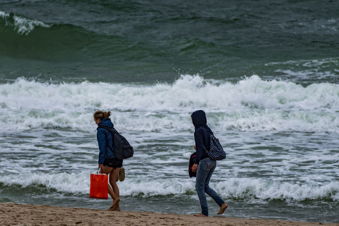 two woman Ankle Deep In Water Beach Beauty In Nature Day Full Length Leisure Activity Lifestyles Motion Nature Northsea Outdoors Real People Rough Sea Sand Scenics Sea Shore Two People Two Woman Vacations Walking Water Wave Waves, Ocean, Nature Weekend Activities