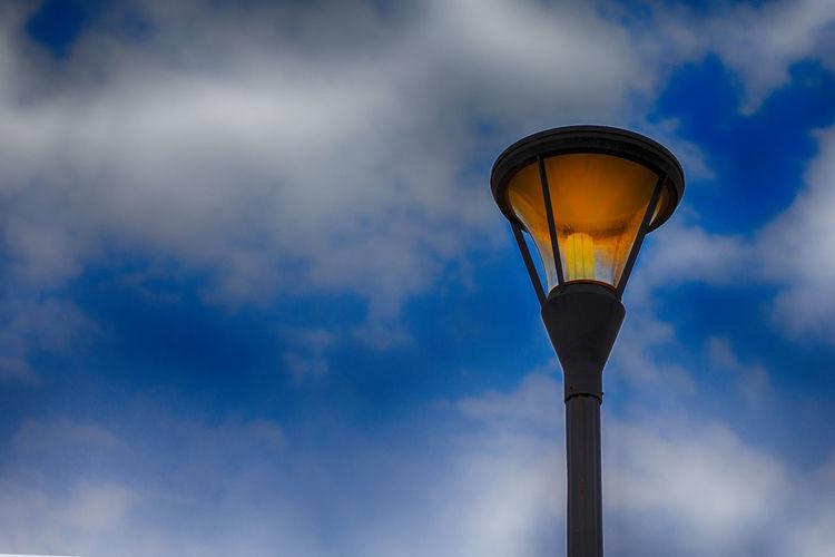 Lamp & Sky Blue Blue Sky Cloud - Sky Day Electric Lamp Electric Light Electricity  Gas Light Glass - Material Illuminated Lamp Light Light - Natural Phenomenon Lighting Equipment Low Angle View Nature No People Orange Color Outdoors Sky Street Street Light