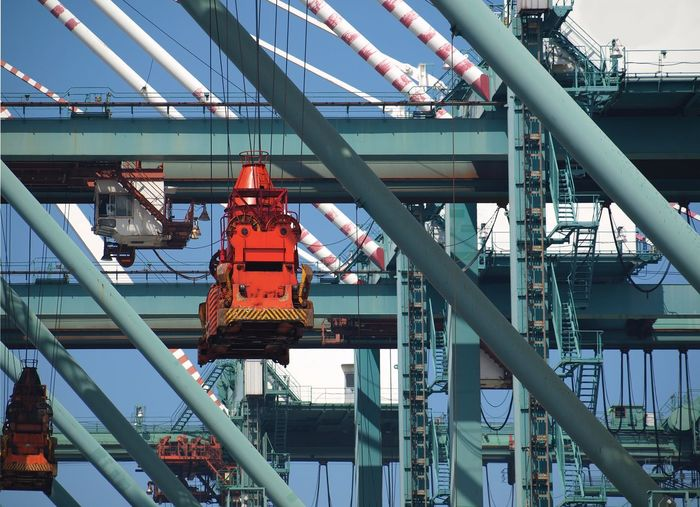 Container and gantry cranes at a busy freight port Transportation Cargo Freight Transportation Logistics Port Harbor Container Crane Gantry Cranes Rails Steel Structure  Steel Cables Cabin Operator Equipment Loading Dock Unloading Trade Commerce