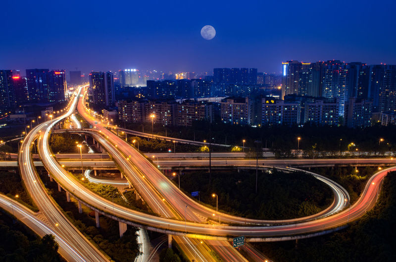 Which one is more beautiful the city or the moon Architecture Blue Sky Bridge Chengdu China City Cityscape Flyover Full Moon Fullmoon Light Trail Modern Moon Night Night Lights Night View Nightphotography Sky