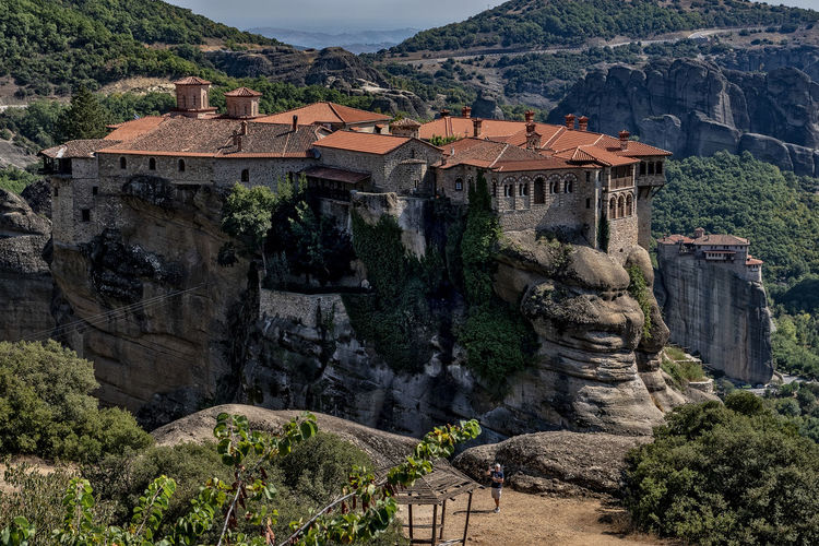 Meteora monastery Unesco World Heritage Architecture Mountain Built Structure Building Exterior Tree Nature Day Plant Rock The Past Solid Travel Destinations Rock Formation Mountain Range Building History Travel No People Rock - Object High Angle View Outdoors Formation