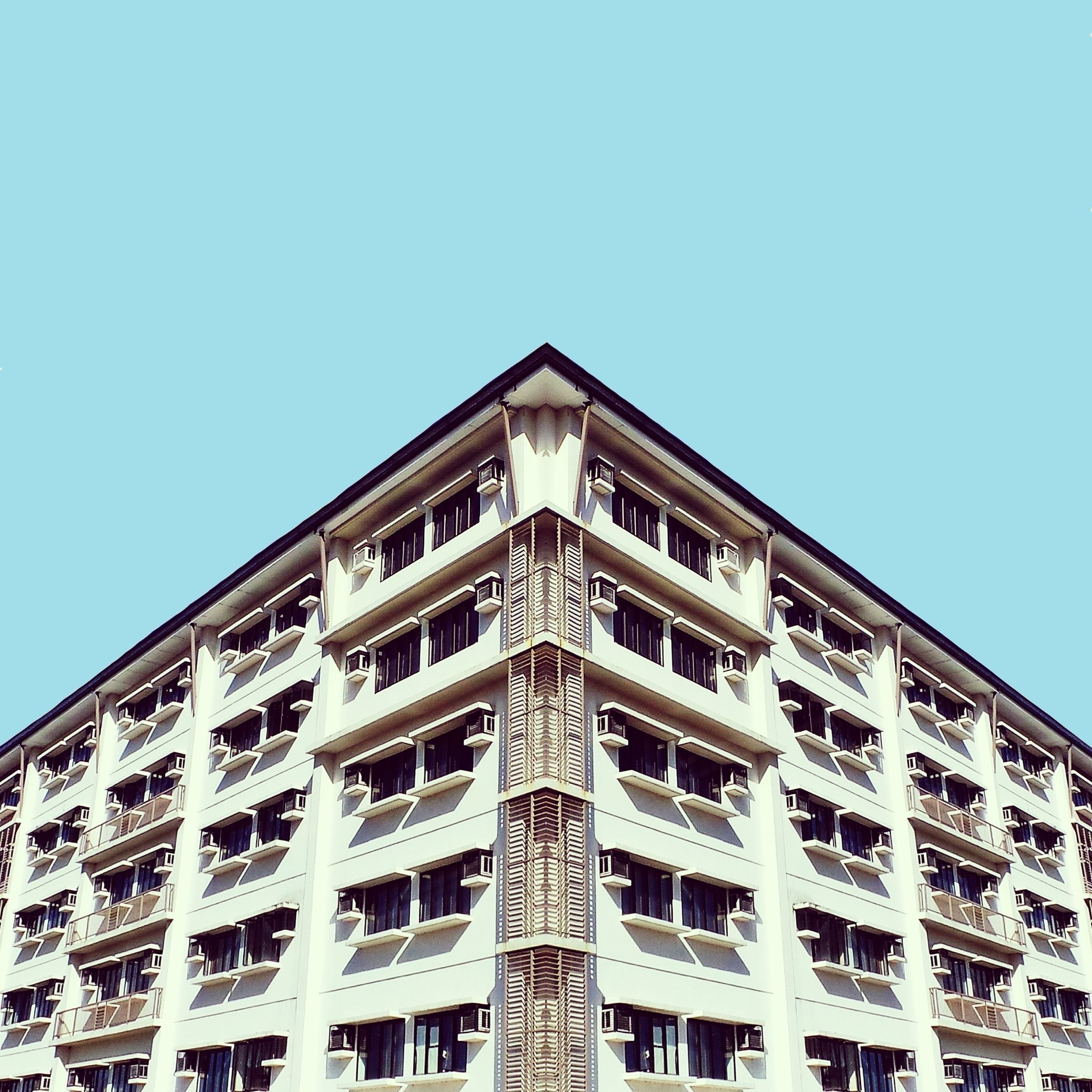 architecture, building exterior, built structure, low angle view, clear sky, window, building, blue, copy space, city, day, residential building, residential structure, outdoors, no people, sky, in a row, modern, high section, apartment