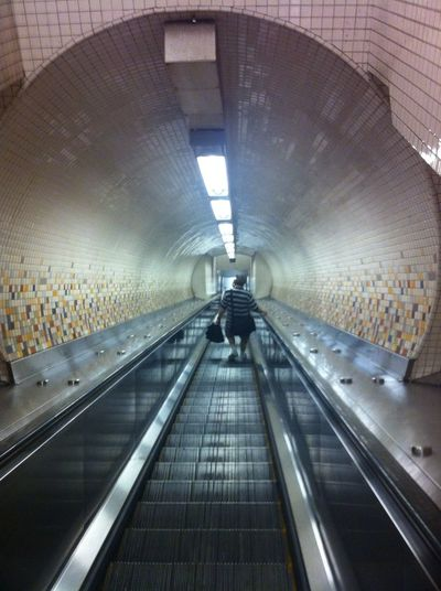 Full Length Modern Illuminated Rear View Walking Tunnel Technology Women Moving Walkway  Escalator Subway Steps And Staircases Underpass Stairs Stairway Elevated Walkway Subway Station