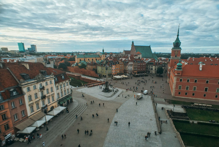 Poland Travel Travel Photography Warsaw Architecture Building Building Exterior Built Structure City City Life Cityscape Cloud - Sky Crowd Day High Angle View Incidental People Nature Outdoors Sky Spire  Street Tourism Transportation Travel Travel Destinations