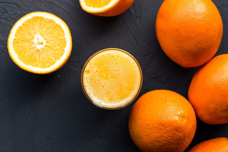 Orange Color Food And Drink Healthy Eating Food Fruit Orange - Fruit Orange Wellbeing Freshness Citrus Fruit Cross Section Still Life Indoors  High Angle View Close-up Table Drink Directly Above Refreshment Glass Ripe Fruit Juice