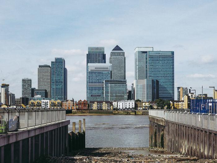 River against modern buildings in city